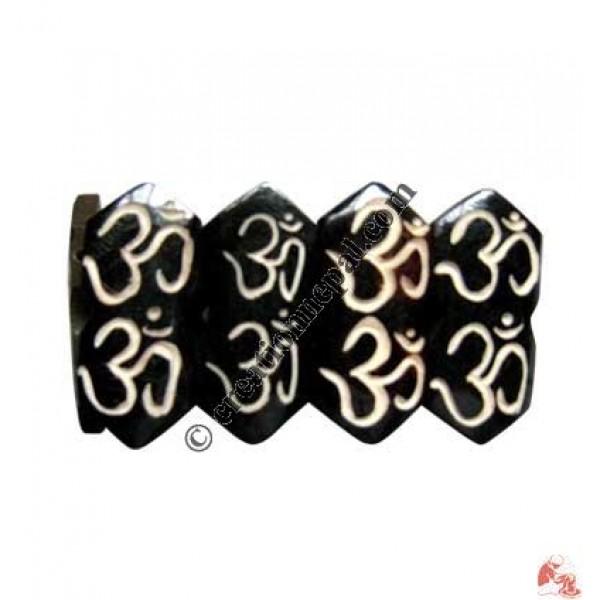 Double OM carved bracelet