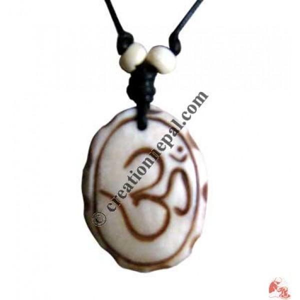 Sanskrit OM ivory oval amulet