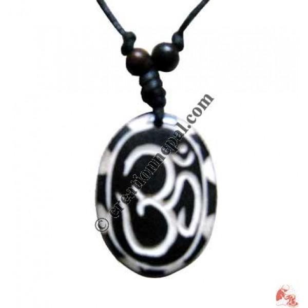 Tibetan OM black oval amulet