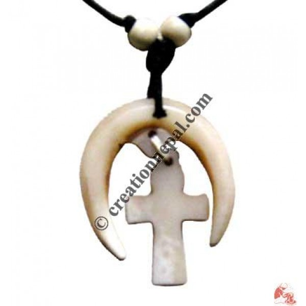 Moon and cross amulet