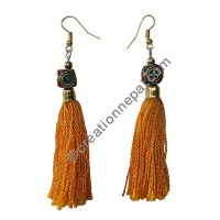 Decorated bead yellow yarn earring