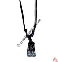 Tibetan Om bone pendant
