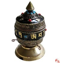 Filigree design table stand prayer wheel
