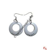 Round white ear ring