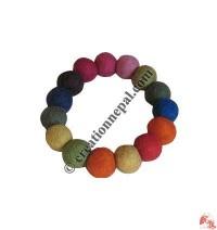 Small plain felt balls wrist band 2
