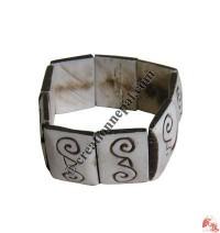 Double spiral carved bracelet
