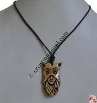 Unique face carved bone pendant