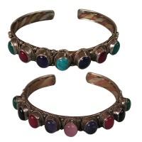 7-stone mixed metal bangle