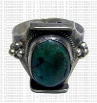 White metal turquoise Tibetan design fingering 2