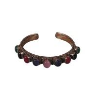 9-stone mixed metal bangle