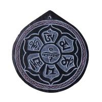 Om Mani carved stone mandala
