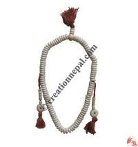 Flat white bone prayer beads