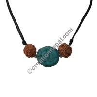 Carved turquoise Rudraksha pendant