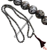 Mantra carved prayer beads