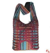Layer-cut gheri bag